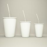 Disposable cup of big volume for beverages with straw on a gray  background. Disposable cup of big volume for beverages with straw high resolution Royalty Free Stock Photos