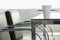 Disposable Cup Pierced By Pencil On Table Royalty Free Stock Images