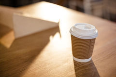 Disposable cup on a table Royalty Free Stock Photos