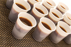 Disposable cups with coffee Stock Images