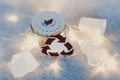 Disposable cups and garbage bin with recycle symbol, concept of reducing single-use plastic royalty free stock photos