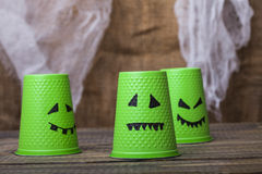 Disposable cups with ghost faces Royalty Free Stock Images