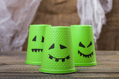 Disposable cups with ghost smiles Stock Image