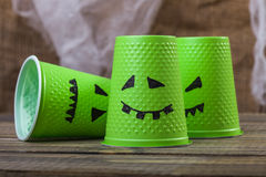 Disposable cups with ghost smiles Stock Photo