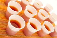 Disposable cups with tea Stock Images