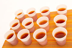 Disposable cups with tea Stock Photos