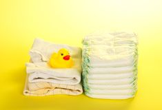 Disposable diapers, clothes and rubber duckling Royalty Free Stock Image