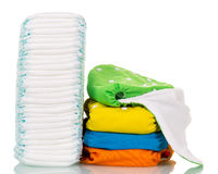 Disposable diapers and eco-friendly fabric isolated on white Stock Photography