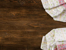 Disposable diapers on wooden background with copyspace Royalty Free Stock Images