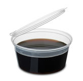 Disposable dipping cup of soy sause. Isolated on white royalty free stock image