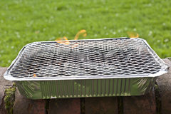 Disposable foil BBQ. Selective focus Royalty Free Stock Photo