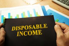 Disposable income written on a note. Disposable income written on a front of note stock photography