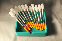 Insulin Needles. Disposable Insulin Syringes, marked in numerical insulin units Royalty Free Stock Images