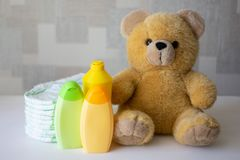 Disposable nappies, baby accessories and teddy bear stock image