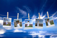 Disposable photo frames hanging in the rope Stock Image