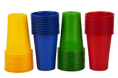 Disposable plastic cups. Multicolor disposable plastic glasses isolated on white background Royalty Free Stock Photography