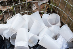 Disposable plastic cups on open container Royalty Free Stock Image