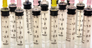 Disposable plastic transparent syringes and needles Royalty Free Stock Photography