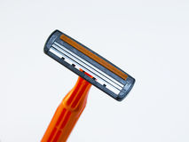 The disposable razor. The shaving machine tool isolated on a white background Royalty Free Stock Photo