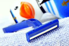 Disposable razor. Lying on a towel-toys for children in the background stock images
