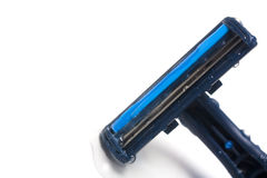 Disposable razor blade. A wet disposable razor blade against a white background Royalty Free Stock Images