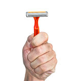 Disposable razor orange color in a human hand Stock Image