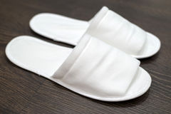 Disposable slippers on the floor in hotel Stock Images