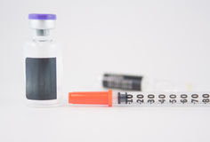 Disposable syringe and injection vials Royalty Free Stock Photography