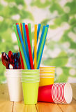 Disposable tableware for a picnic on the wooden table Royalty Free Stock Photography