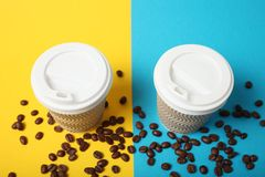 Disposable takeaway coffee in paper cup.  royalty free stock photos