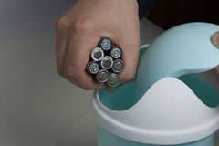Disposal of batteries in the container. Stock Photos