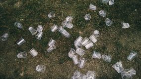 Disposal glasses. Threw on the ground, green , grasses,white, transparent stock images