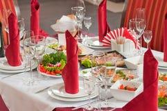Disposição da tabela para um banquete. Fotografia de Stock
