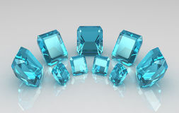 Disposição de pedras azuis cortadas esmeralda de aquamarine Fotos de Stock