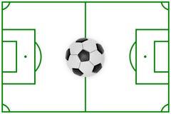 Disposición de un campo de fútbol y de una bola Imágenes de archivo libres de regalías