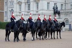 Dispositifs protecteurs royaux de Londres sur des chevaux Photos stock