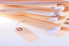 Dispositivi di piegatura con i documenti dell'ufficio Fotografia Stock Libera da Diritti