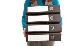 Dispositivi di piegatura della holding della donna di affari Fotografia Stock