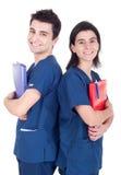 Dispositivi di piegatura della holding della squadra dei medici Immagine Stock