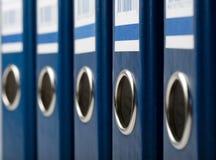 Dispositivi di piegatura di archivio blu Fotografia Stock