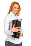 Dispositivi di piegatura esecutivi della holding della donna Fotografie Stock