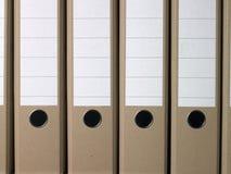 Dispositivi di piegatura marroni normali dell'ufficio Immagine Stock Libera da Diritti