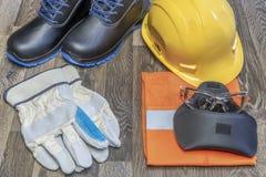 Dispositivi di protezione individuale sul lavoro fotografia stock libera da diritti