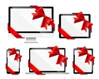 Dispositivi moderni con gli archi rossi Fotografia Stock Libera da Diritti