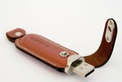 Dispositivo de almacenamiento con la cubierta de cuero Fotografía de archivo libre de regalías