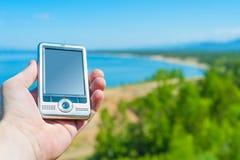 Dispositivo de la navegación GPS disponible Fotografía de archivo libre de regalías