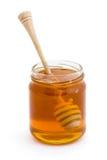 Dispositivo di gocciolamento del miele in un vaso di miele fotografia stock libera da diritti