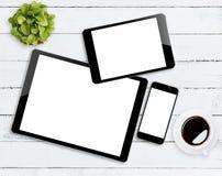 Dispositivo do comunicador na tabela de madeira imagem de stock