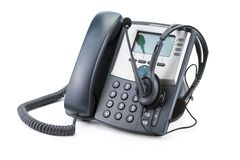 Dispositivo do telefone do IP com os auriculares isolados no branco Fotos de Stock Royalty Free
