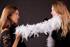 Dispositivo lubricante e piume carnaval delle ragazze Fotografie Stock